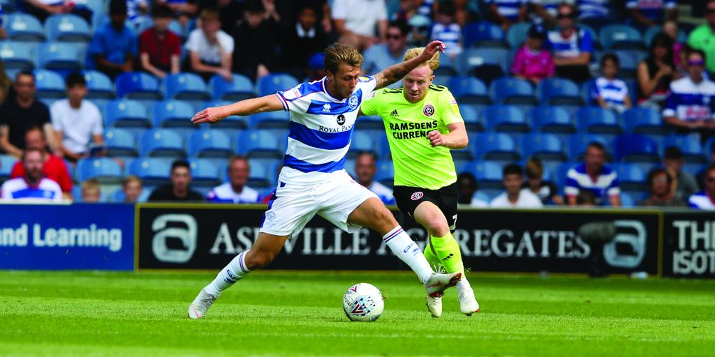 Luke Freeman battles for the ball