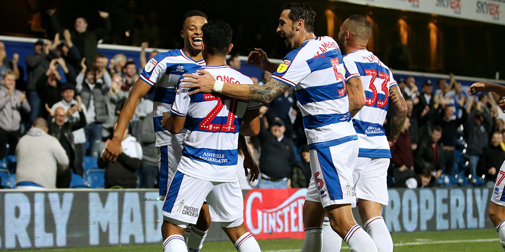 The lads celebrate with Massimo Luongo